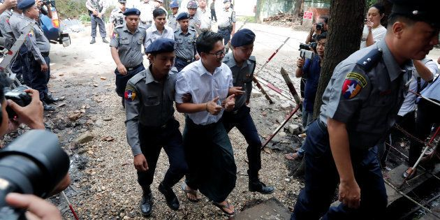 Detained Reuters journalists Wa Lone and Kyaw Soe Oo arrive to listen to their verdict at Insein court...