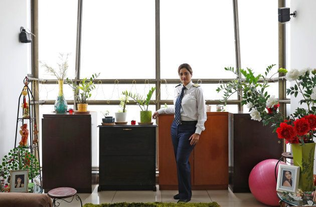 Shweta Singh, a Jet Airways pilot, poses for a picture inside her house in Gurugram,