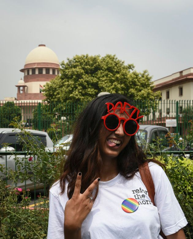 A girl poses outside the Supreme Court on