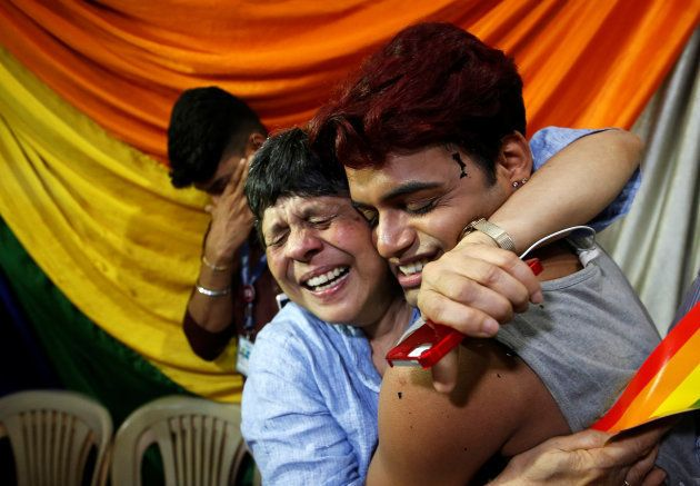 Two people hug each other at an NGO in Mumbai after the Supreme Court verdict on Section 377 on