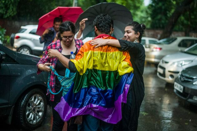 People celebrate on the streets of Delhi despite torrential