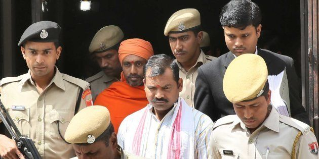 JAIPUR, INDIA - MARCH 16: The accused Devendra (Center) and Bhavesh Patel, convicted in the ajmer blast