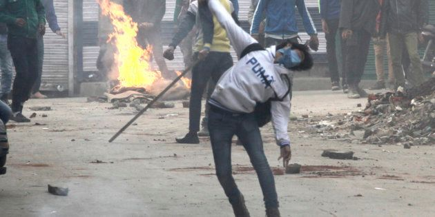 A file photo of demonstrators pelting stones during clashes in Jammu and