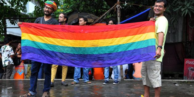 Members of LGBT community celebrate at the Supreme Court of India after the decision to strike down the...