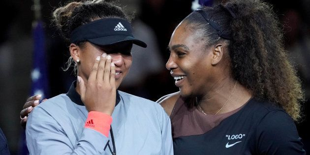 Naomi Osaka of Japan (left) cries as Serena Williams of the USA comforts her after the crowd booed during...