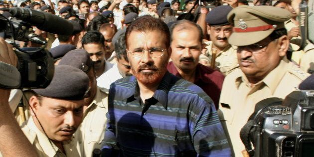 File photo -- DG Vanzara being escorted by the police following an appearance in the magistrates court...