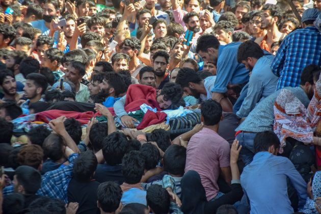 Mourners at the funeral of Altaf Ahmad Dar.