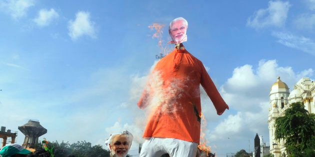Trinamool Congress (TMC) members burned an effigy of Prime Minister Narendra Modi in a protest demonstration...