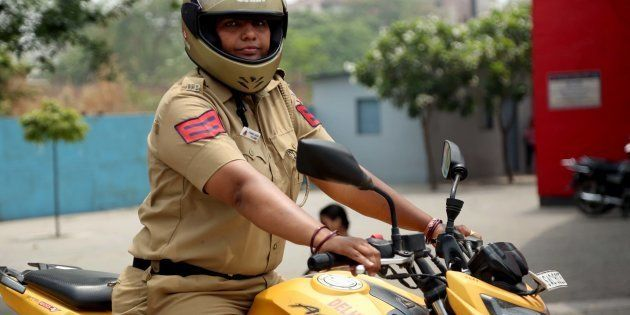 NEW DELHI- INDIA - JUNE 8: A lady policewoman on bike deployed at Delhi University North Campus on June...