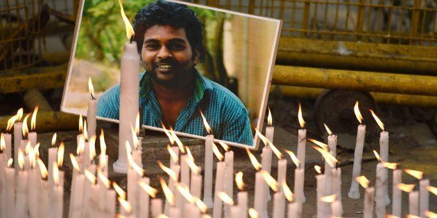 Activists of various organizations participate in a candlelight march to observe Rohith Vemula's first...