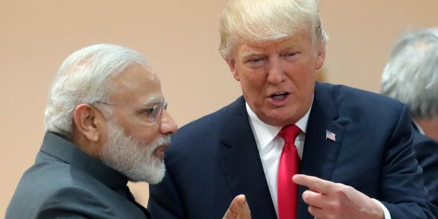 U.S. President Donald Trump chats with Prime Minister Narendra Modi during a working session at the G20...