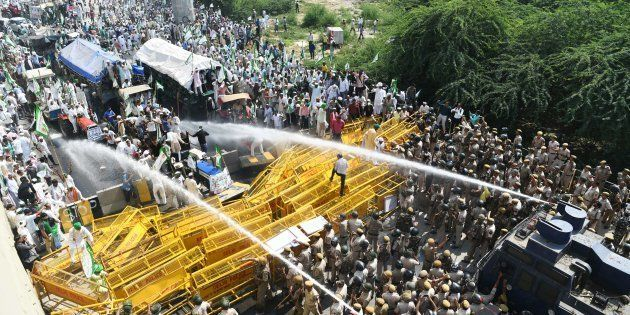 New Delhi police use water canons to disperse and stop farmer activists of the Bhartiya Kisan Union at...