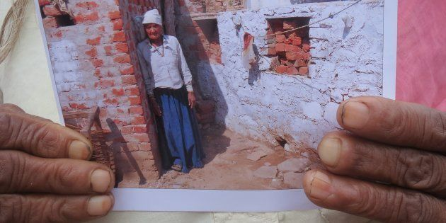Angoori Khati of Jilota in Rajasthan, with the photo she had to show to claim Rs 12,000 reimbursement...