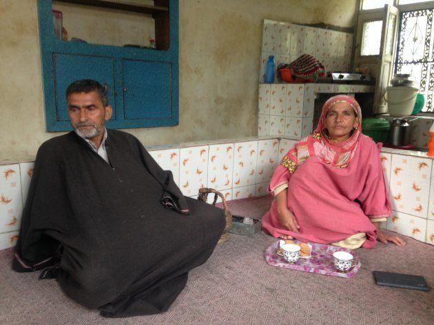 Naikoo's parents Asadullah and
