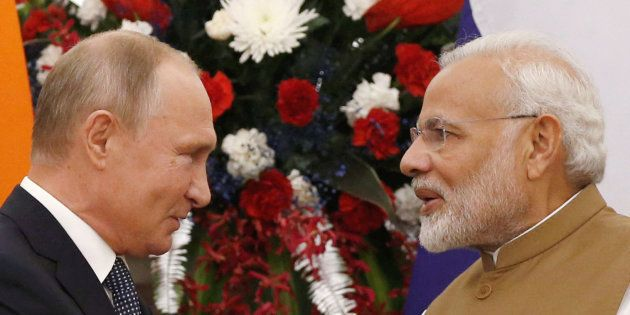 Russian President Vladimir Putin and India's Prime Minister Narendra Modi are seen after delivering a...