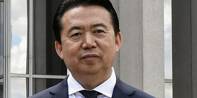 INTERPOL President Meng Hongwei poses during a visit to the headquarters of International Police Organisation...