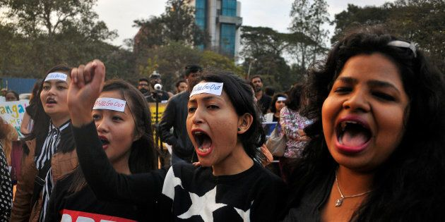 Women shout slogans as they take part in the #IWillGoOut rally, to show solidarity with the Women's March...