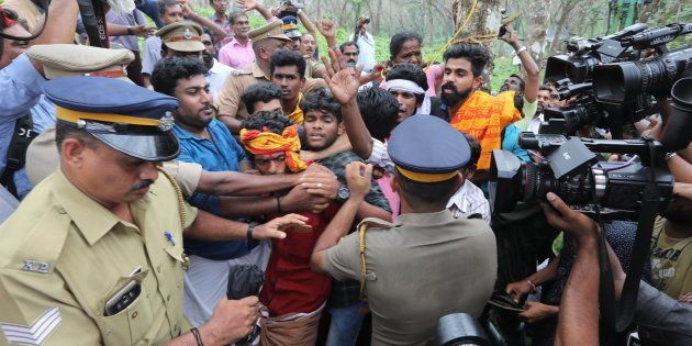 Ratnaamma, a Hindu devotee is surrounded by other devotees as she threatens to commit suicide in protest...