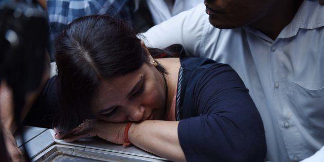 Apple executive Vivek Tiwari's wife at his