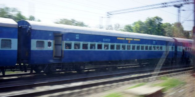 Indian Passenger Train moving alongside, Delhi,