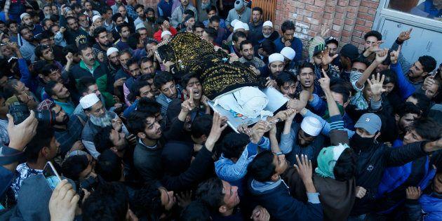 Kashmiri villagers carry the body of Uzair Mushtaq during his funeral in Kulgam 75 Kilometers south of...