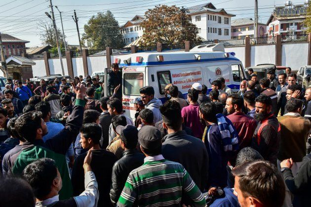 An ambulance carrying civilians injured in the explosion arrives at a hospital in Srinagar on
