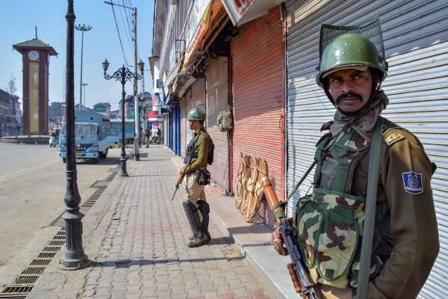 Army men stand guard on the deserted streets of Srinagar on