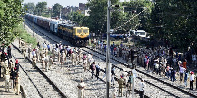 Amid high security the railway tracks were cleared by dispersing agitating people, near the site of train...