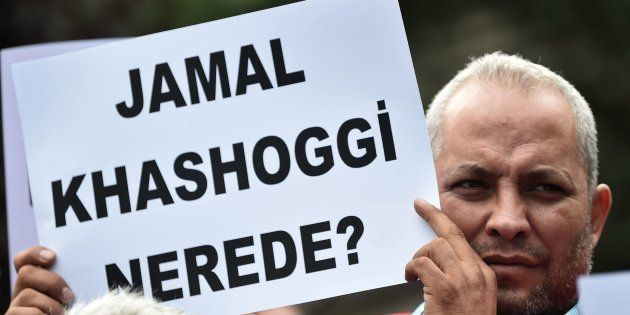 A man holds a placard reading 'Where is Jamal Kashoggi ?' during a demonstration in support of missing...