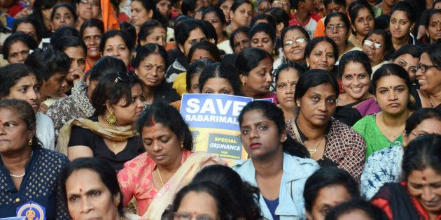 Women hold placards as they attend a protest rally called by various Hindu organisations against the...