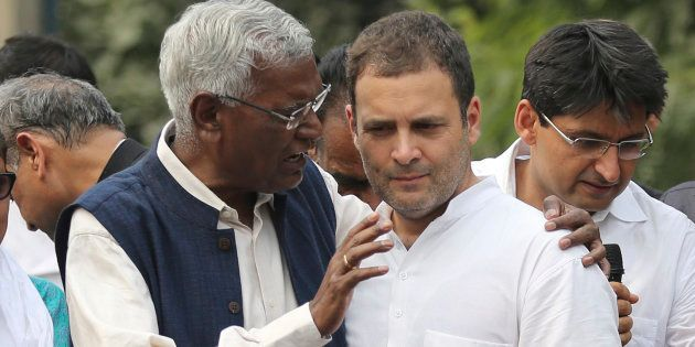 Communist Party of India's Rajya Sabha MP D. Raja, left, speaks with Congress party president Rahul Gandhi...
