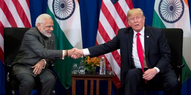 File picture of Donald Trump and Narendra