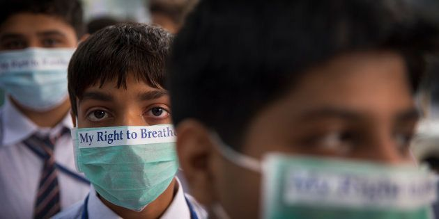 School children take out march to express their distress on the alarming levels of pollution in the city,...