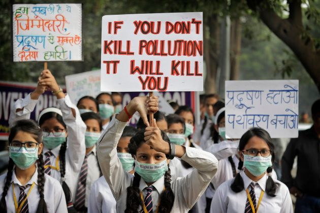 School children hold banners take out march to express their distress on the alarming levels of pollution...