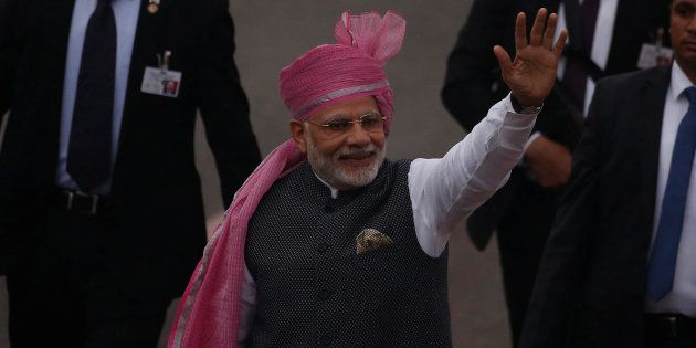 PM Narendra Modi waves towards the crowd as he leaves after attending the Republic Day parade in New...