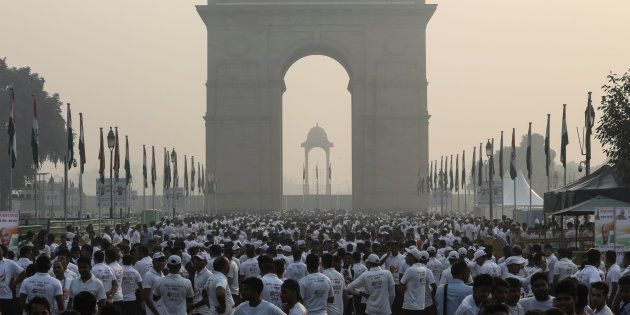 India Gate is shrouded in smog as people participate in 'Run For Unity' to mark the 143rd birth anniversary...