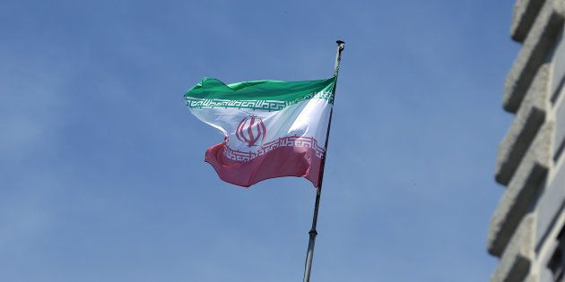The national flag of Iran is seen on top of the Austrian Chancellery during the visit of President Hassan...