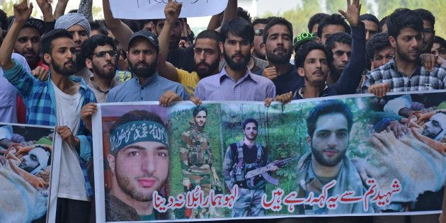 People raise slogans during a protest inside the Kashmir University campus on the second death anniversary...