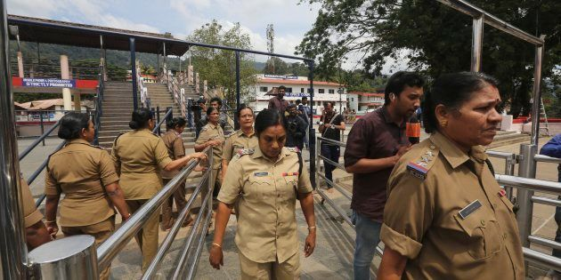Police women above the age of 50, who have been deployed for security, return after worshipping at the...