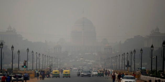 India's Rashtrapati Bhawan, or the Presidential Palace is partly visible due to smog as traffic plies...