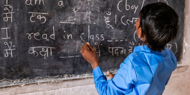Indian schoolboy in classroom, English language class, Rajasthan,