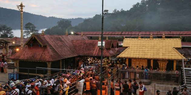 Hindu devotees wait in queues inside the premises of the Sabarimala temple in Pathanamthitta district...