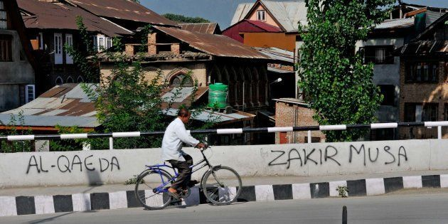 SRINAGAR, INDIA - AUGUST 5: Names of newly established Al-Qaeda's wing and its commander Zakir Musa can be seen in graffiti, on August 5, 2017 in Srinagar, India. (Photo by Waseem Andrabi/Hindustan Times via Getty Images)