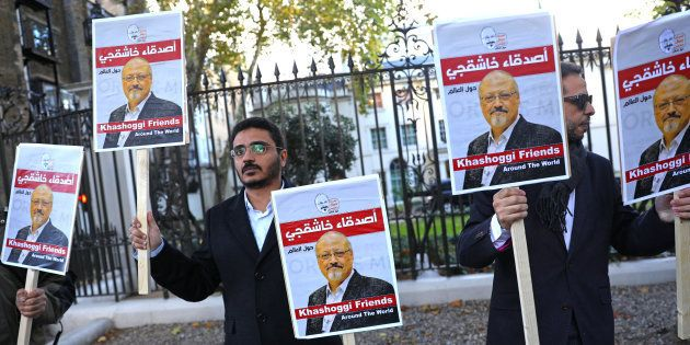 People protest against the killing of journalist Jamal Khashoggi in Turkey outside the Saudi Arabian...
