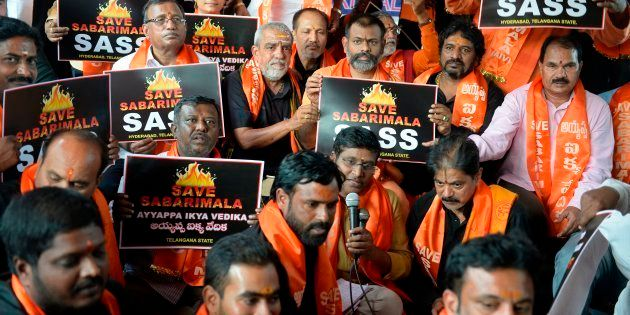 Members of the Sabarimala Ayyappa Seva Samajam hold placards during a protest in Hyderabad on 20