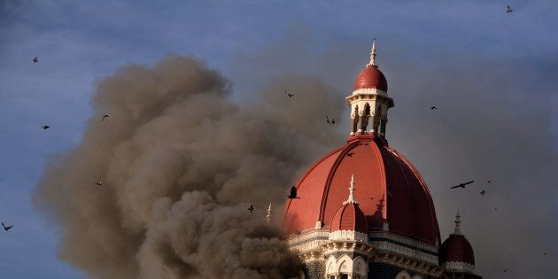 Smoke billows from under the main dome of the Taj Palace Hotel in Mumbai on 27 November