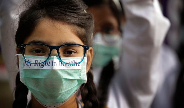 School children march to protest the alarming levels of pollution in New Delhi.