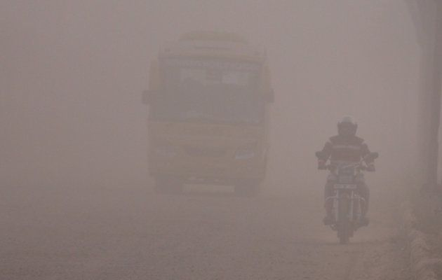 Commuters on a dusty road in