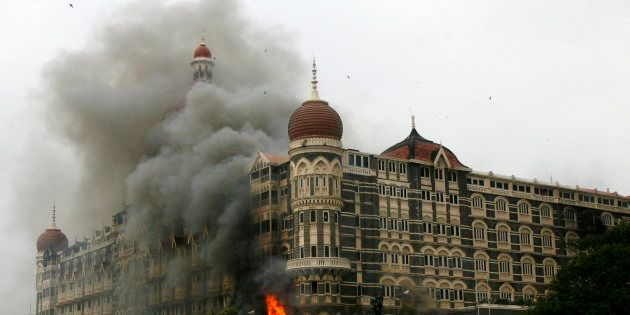 The Taj Mahal hotel is seen engulfed in smoke during the 2008 Mumbai