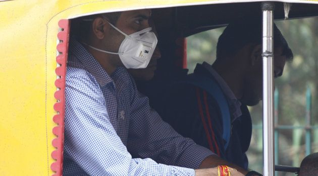 GURUGRAM, INDIA - NOVEMBER 9: A man wears an anti-air pollution mask as a protective gear amid heavy...